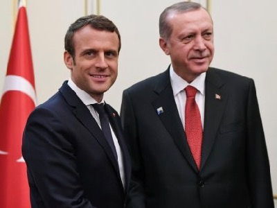 French President Emmanuel Macron (L) and Turkish President Recep Tayyip Erdogan (R) shake hands ahead of a meeting on the sidelines of the NATO (North Atlantic Treaty Organization) summit, in Brussels, on May 25, 2017. / AFP PHOTO / POOL / Eric FEFERBERG        (Photo credit should read ERIC FEFERBERG/AFP/Getty Images)